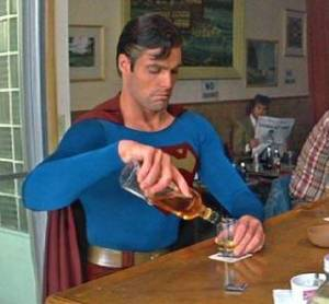 Superman getting drunk in a bar